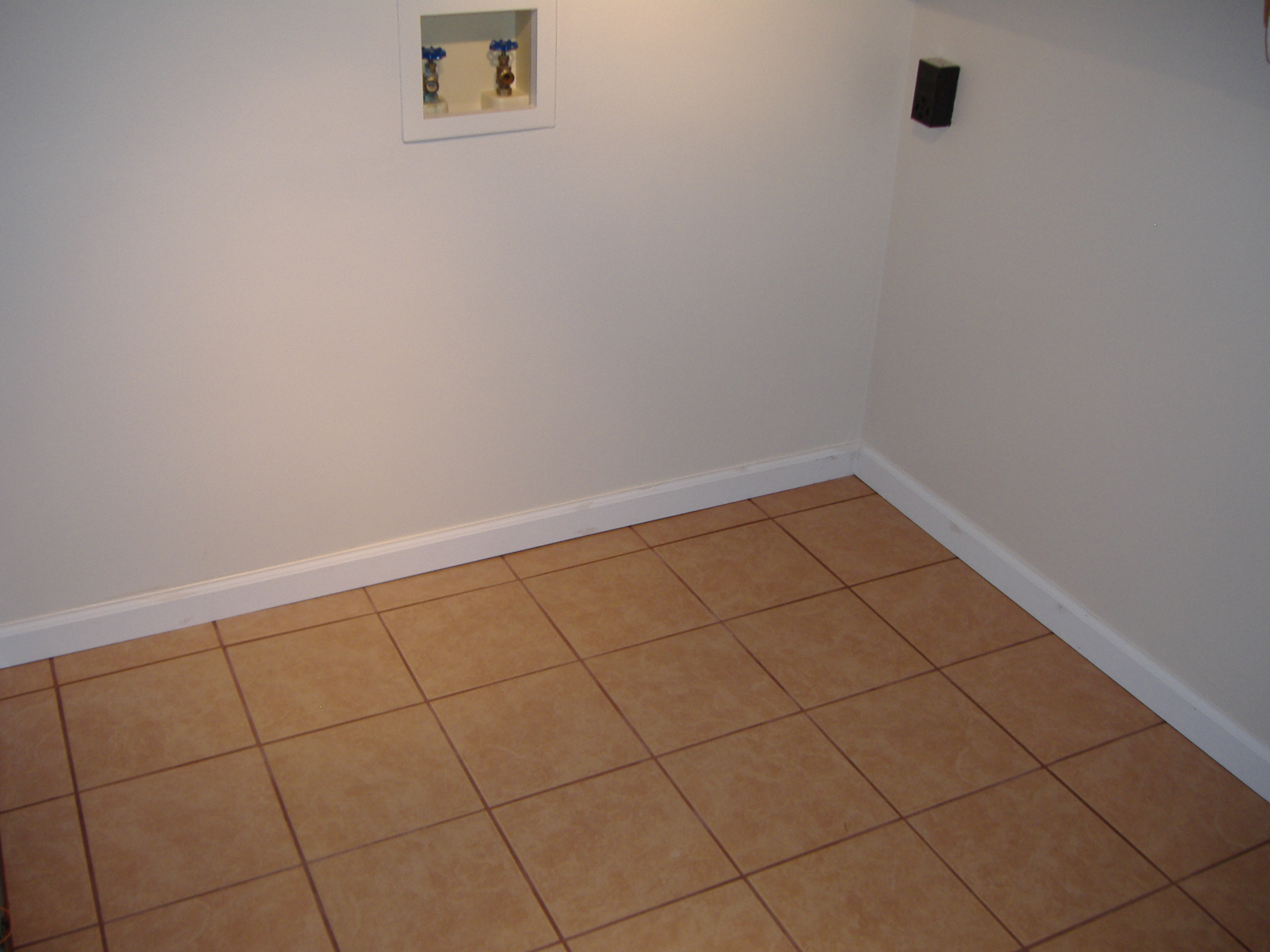 Once The New Drywall Was Installed Finished And Painted Ceramic Tile Floor Finishing With Base Boards